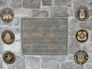 The 6 bronze plaques representing the 5 branches if the service and the Merchant Marines were added in 2013 when the wall was repointed
